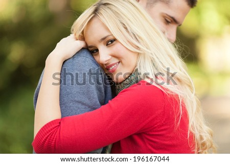 Couple embracing in a park - stock photo