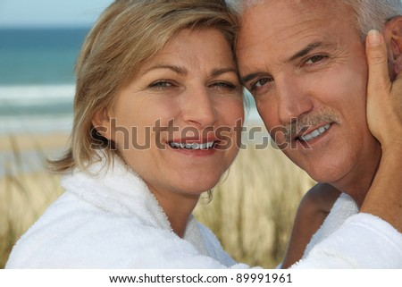 Couple enjoying a relaxing holiday by the seaside - stock photo