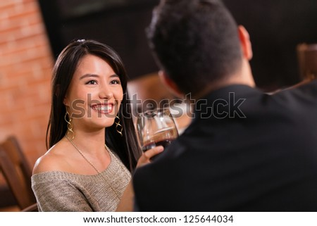Couple enjoying dinner together at a restaurant - stock photo