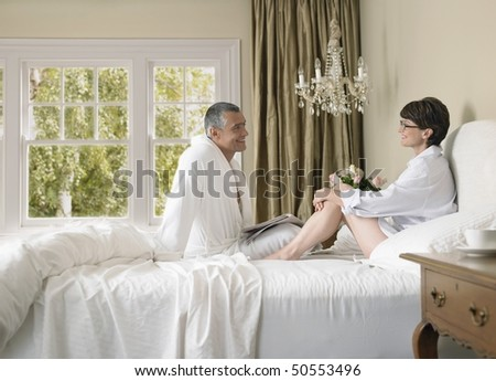 Couple enjoying lazy morning in bed