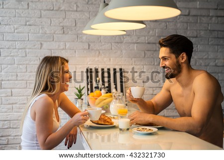 Couple enjoying morning coffee and breakfast together. - stock photo