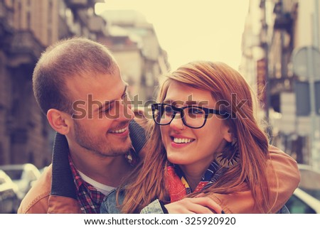 Couple enjoying outdoors in a urban surroundings. - stock photo