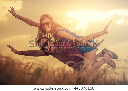Couple enjoying outdoors in a wheat field. - stock photo