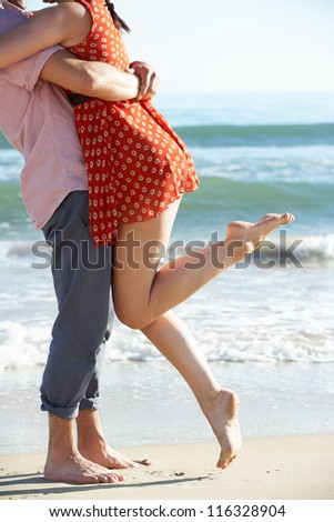 Couple Enjoying Romantic Beach Holiday - stock photo
