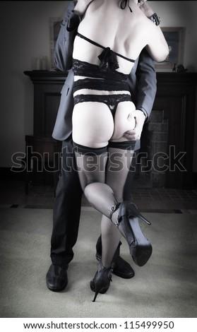Couple enjoying some adult time - stock photo