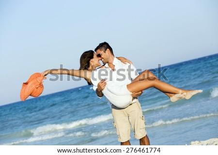 Couple enjoying their honeymoon in the Caribbean - stock photo