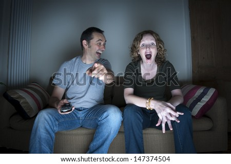 couple enjoying watching television together - stock photo