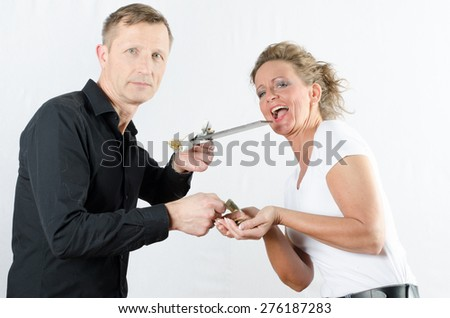 couple exchanging money against chocolate