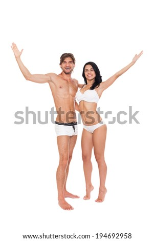 couple excited smile hold raised hands arms, wear swimsuit, young man and woman summer vacation full length isolated over white background