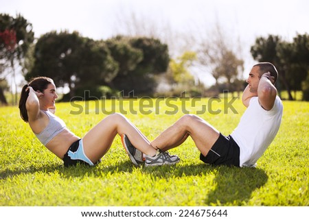 Couple exercising at the city park - stock photo