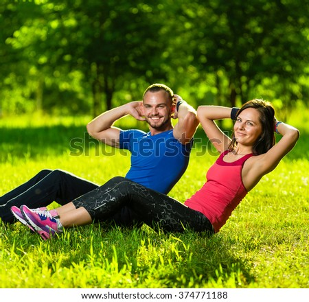 Couple exercising at the city park. Outdoor sport - stock photo