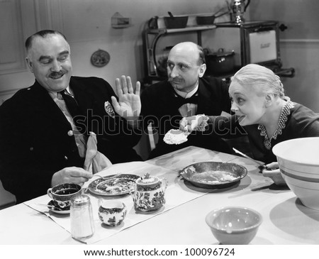 Couple feeding police officer - stock photo
