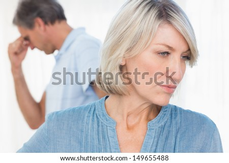 Couple feeling distant after fight at home - stock photo