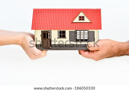 Couple fight over a house.Concept of lives breaking up - stock photo