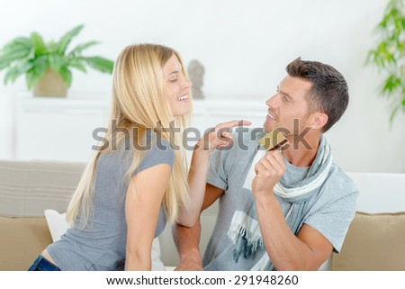 Couple fighting over possession of credit card - stock photo