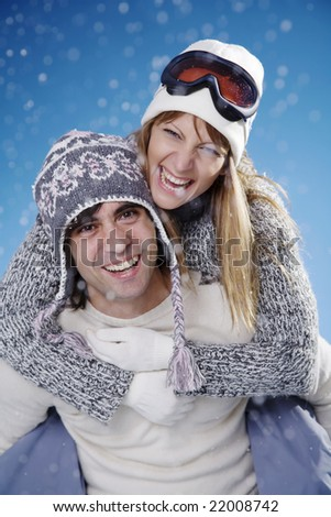 couple fooling around in the snow