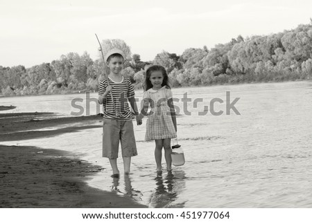 couple, funny boy and girl on the river summer day.Black and white toned photo stylized vintage style - stock photo
