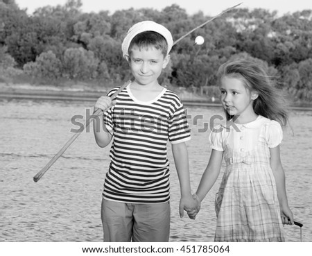 couple, funny boy and girl summer portrait of friend.Black and white toned photo stylized vintage style  - stock photo