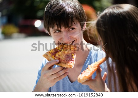 Couple gazing at each other while having pizza