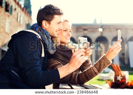 couple gets a Selfie while drinking aperitif - stock photo