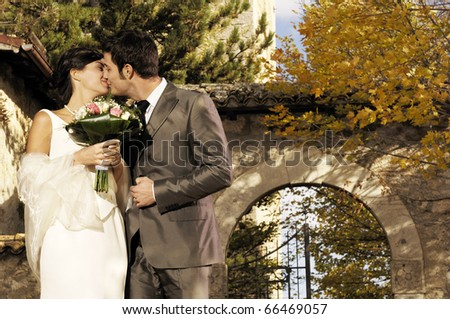 Couple getting married and kissing - stock photo