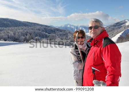 Couple going cross-country skiing - stock photo