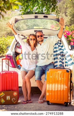 Couple going on summer vacation. Car travel concept - stock photo