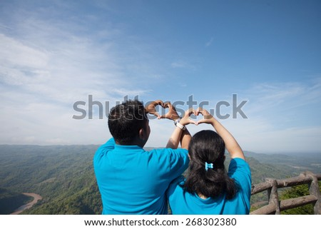 Couple hand in heart form love blue sky - stock photo