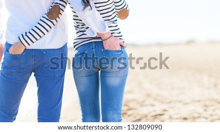 Couple Hands In Each Other Pocket, Beach - stock photo