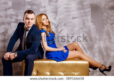 Couple. handsome businesslike man in suit posing with beautiful blond hair girl  - stock photo