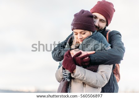 Couple has fun and laughs  kiss  Young hipster couple hugging each other in  winter. Couple Hugging Stock Images  Royalty Free Images   Vectors