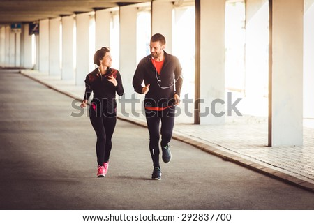 Couple have conversation while running - stock photo