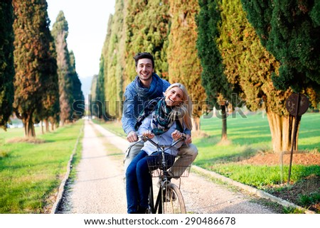 Couple having a bicycles race into the nature