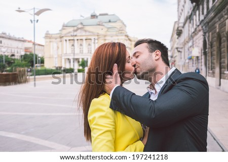 Couple having a great time in the city - stock photo
