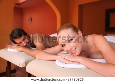 Couple having a massage for honeymoon - stock photo