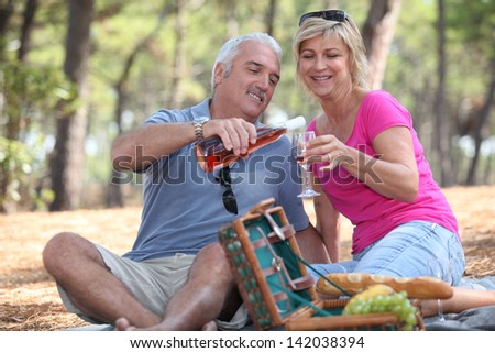 Couple having a picnic - stock photo