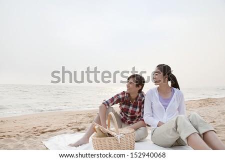 Couple Having a Romantic Picnic on the Beach - stock photo