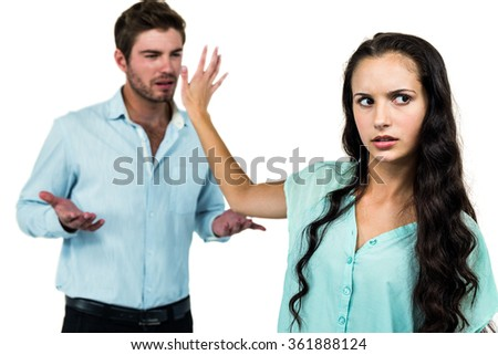 Couple having an argument over white background - stock photo