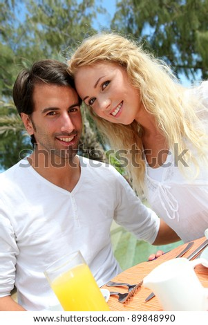 Couple having breakfast in luxury resort