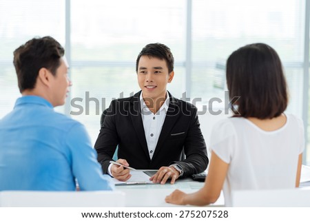 Couple having consultation with real estate broker - stock photo