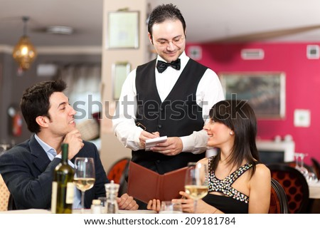 Couple having dinner - stock photo