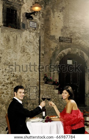 couple having dinner in an old rural village - stock photo