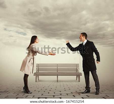 couple having fallen out at outdoor - stock photo