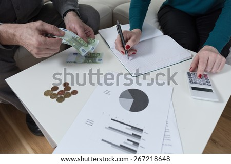 Couple having financial problems and analyzing family budget - stock photo