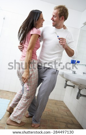 Couple Having Fun In Bathroom Brushing Teeth - stock photo