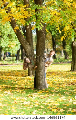 Couple having fun in park on a fall day - stock photo