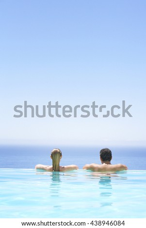 Couple having fun in swimming-pool - stock photo