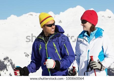 Couple Having Fun On Ski Holiday In Mountains - stock photo