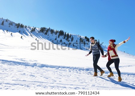 Couple having fun running down slope