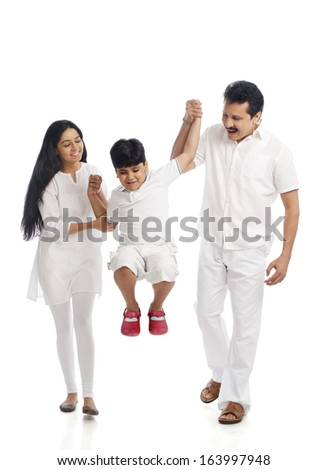 Couple having fun with their son